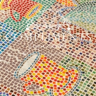 "the ""famous"" mosaic coffee cup coffee table close up"