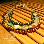 multi colored pearl and stone necklace on ribbon