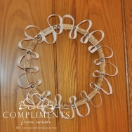 whimsical wine cork wreath with white ribbon