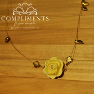 yellow rose pendant on gold leaf necklace