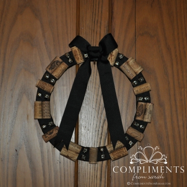 black wine cork wreath with jingle bells